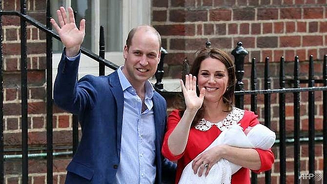 britains prince william and kate return home with newborn son