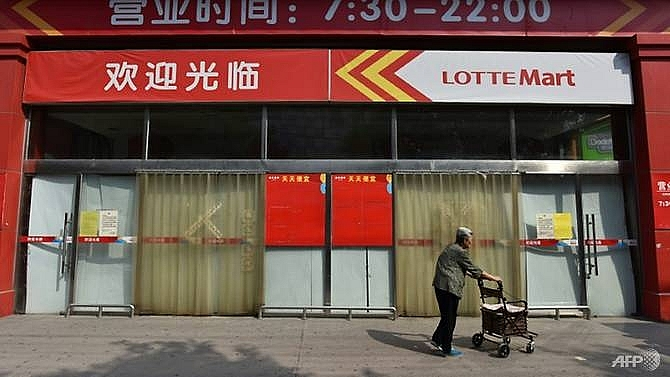 south koreas lotte to sell some china stores after missile row