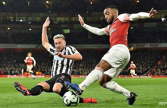 arsenal move up to third as ramsey lacazette sink newcastle