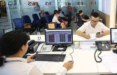 vietnam stocks inch up amid market caution