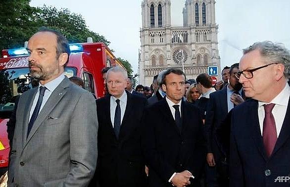 we will rebuild notre dame together says frances macron