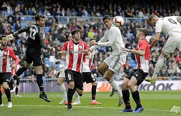 benzemas hat trick fires real madrid past bilbao