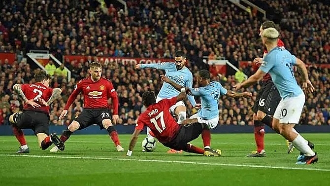 man city pile on misery for man utd to go back top