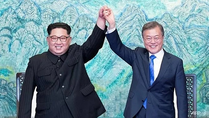 two koreas mark moon kim summit anniversary with different tones