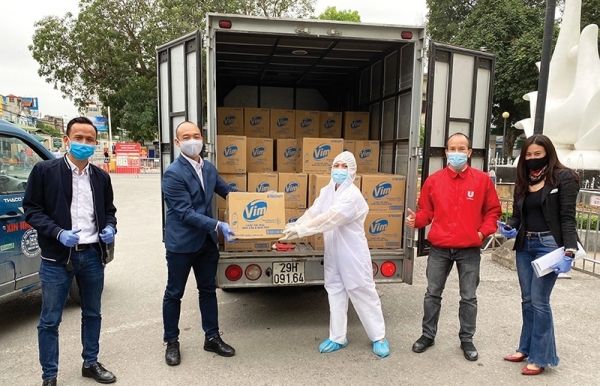 unilever vietnam standing next to health professionals in virus battle