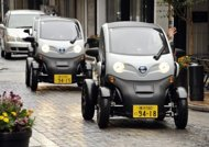 This file photo shows people driving Japanese auto giant Nissan's New Mobility Concept cars, during a press preview in Yokohama, suburan Tokyo, in 2011. Nissan on Friday posted a $4.28 billion full-year net profit and record sales as the automaker shrugged off the devastating impact of last year's quake-tsunami disaster on production