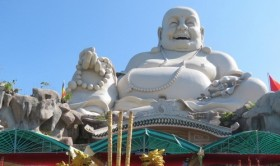 buddha statue recognized as biggest on any mountain in asia