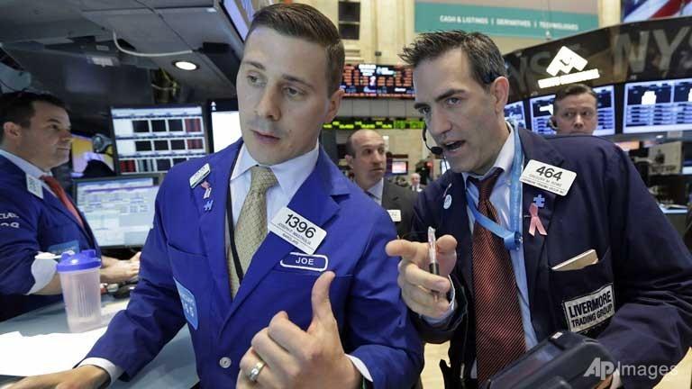 Traders work on the floor of the New York Stock Exchange. ( Photo source: AP/Richard Drew)