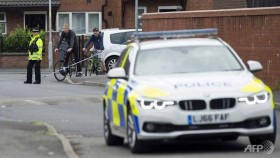 Police launch new raids as Manchester runners defy terror threat