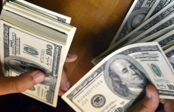 dollar holds gains as fed looms asia markets mostly drop