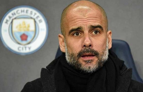 guardiola signs new contract to remain at man city until 2021