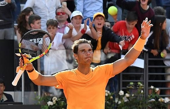nadal eases past shapovalov and into rome last eight