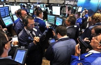 wall street swings to split finish as trade unease persists