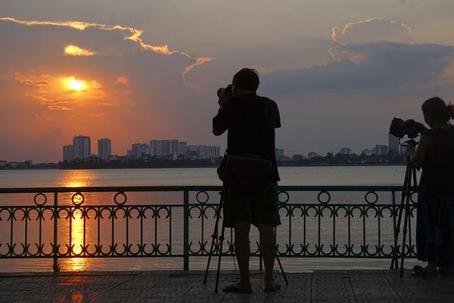 beautiful sunset on hanois west lake