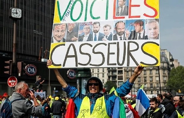 paris on edge as thousands gather for may 1 rallies