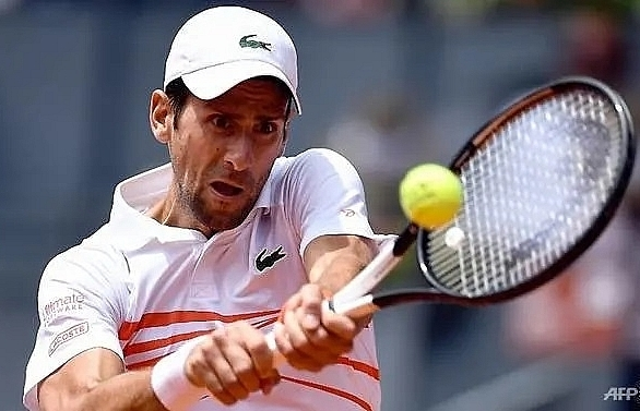djokovic destroys fritz in madrid open as osaka fights on