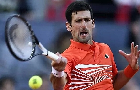 djokovic wins third madrid open title and 33rd masters