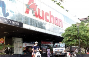 auchan throws in towel over tough competition