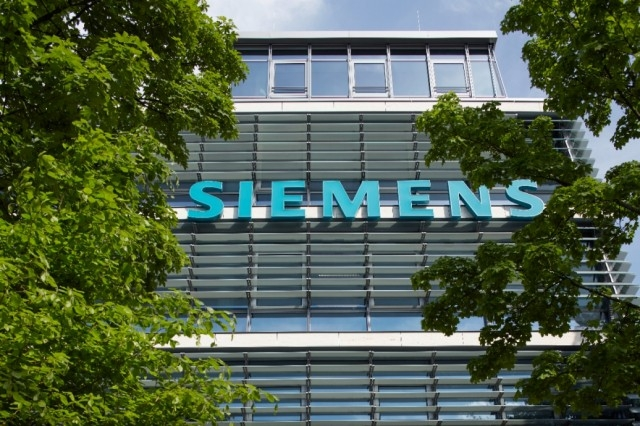 siemens ups outlook after tripling profit in q2