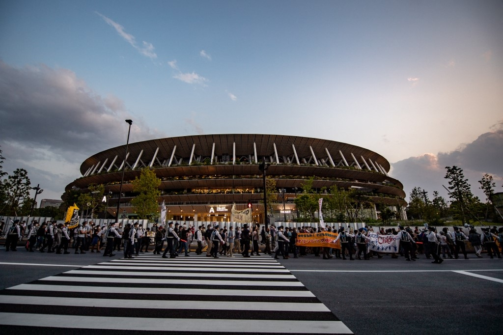 olympic chiefs japan visit postponed over virus