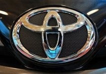 toyota sees net profit fall 31 pc