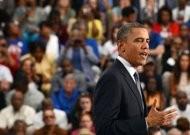 obama romney go head to head on economy