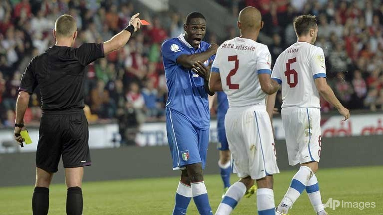 Italy's Mario Balotelli (C) receives the red card from the referee after a foul on Czech Republic's Theodor Gebre Selassie, (2nd R) during the World Cup group B qualifying soccer match in Prague, Czech Republic.  (Photo source AP/Martin Meissner)
