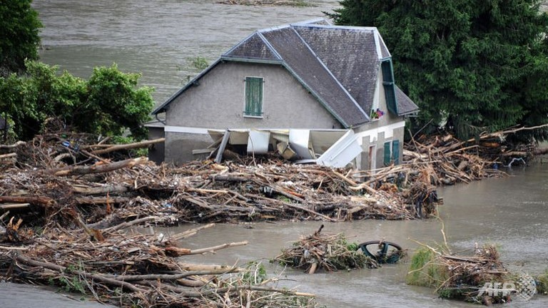 A flooded house is pictured one day after the village of Saint-Beat was submerged by flash floods.  (AFP/Pascal Pavani)