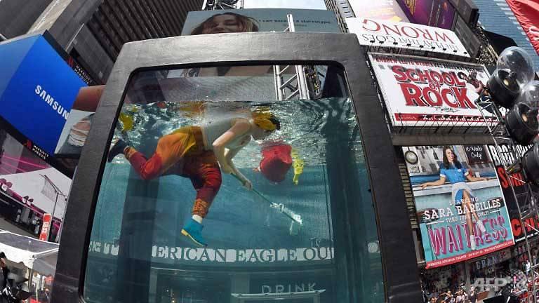 Aquarium Art Brings Climate Debate To Ny Times Square