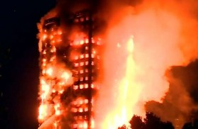 Huge fire engulfs 27-storey Grenfell Tower apartment block in London