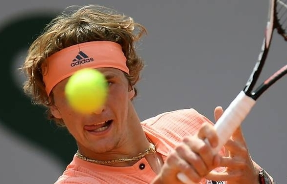 zverev fights back again to reach first slam quarter final