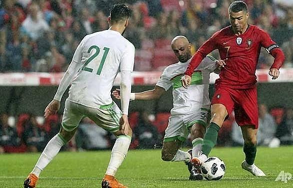 ronaldos return inspires portugal past algeria