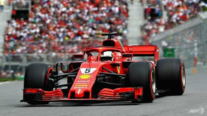 vettel claims 50th win and goes top in title race