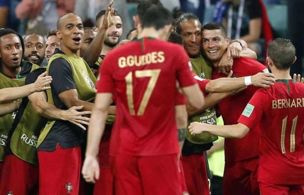 world cup ronaldo hits hat trick as portugal deny spain