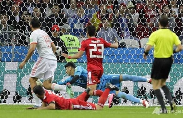 world cup lucky costa goal sees spain past dogged iran