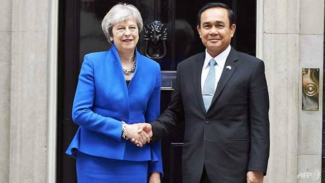 uk pm calls for free elections in thailand