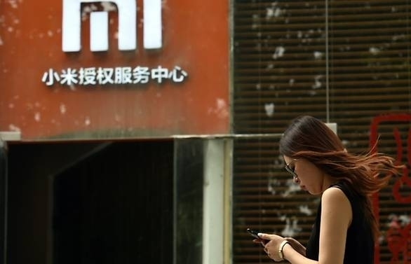 Xiaomi lowers target as it kicks off IPO
