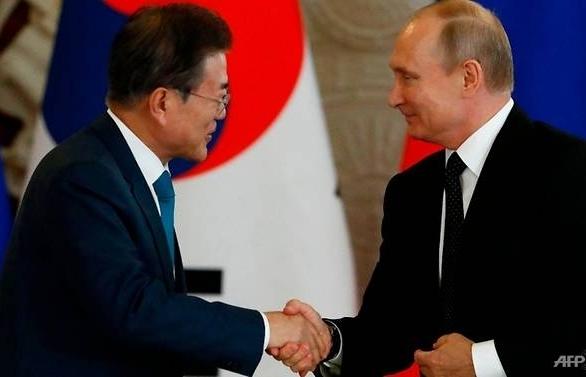 putin invites two koreas to economic summit