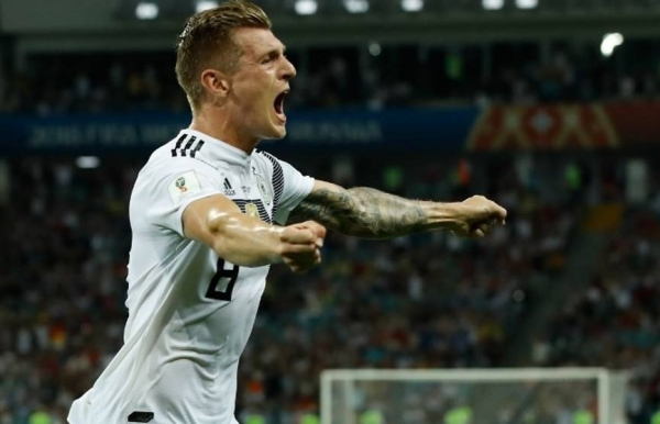 germany hold nerve as kroos brings world cup holders back from brink