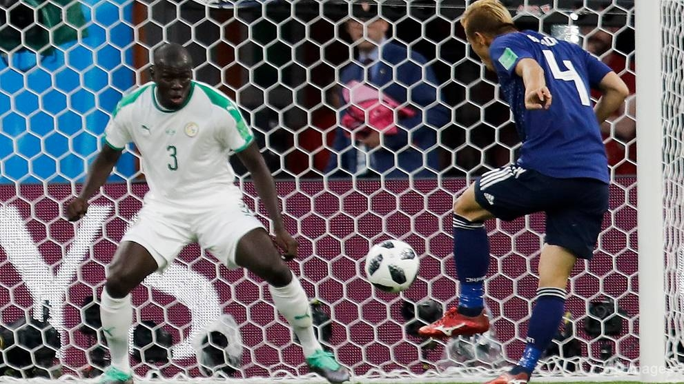 senegal japan play out 2 2 thriller to keep world cup last 16 hopes alive