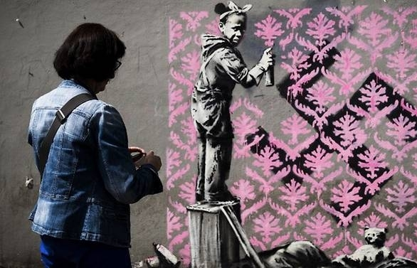 banksy needles france on migrants with paris mural blitz