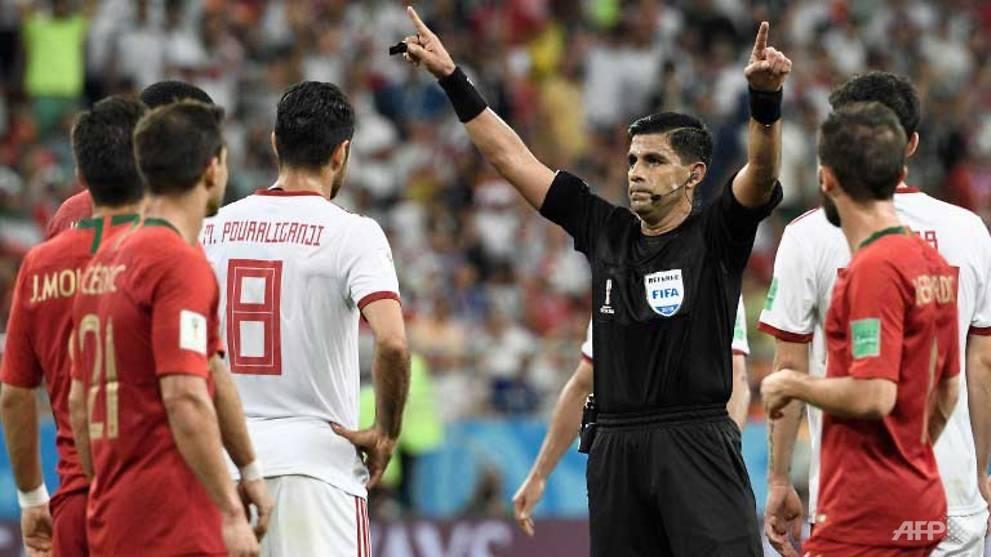 world cup var drama as portugal and spain reach last 16