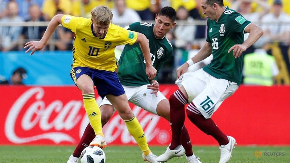 world cup swedes beat mexico 3 0 but both through to last 16