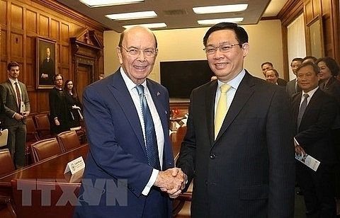 deputy pm discusses trade investment with us officials