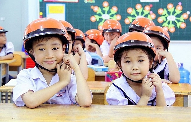 programme encourages children in yen bai to wear helmets