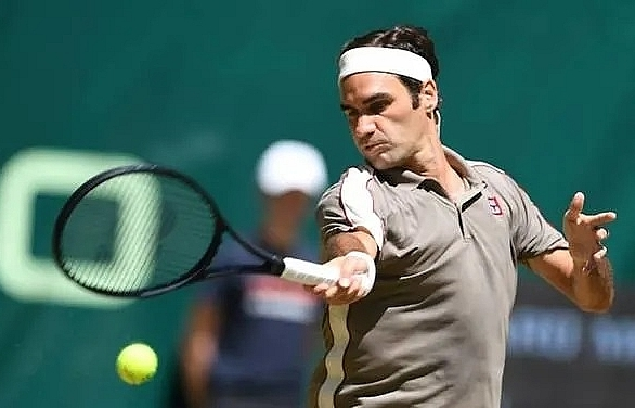 federer crushes goffin for 10th halle title
