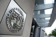 The International Monetary Fund (IMF) headquarters in Washington, DC. The International Monetary Fund warned Tuesday that the Obama administration could be slicing the deficit too fast for the weak US economy as it pared its growth forecast. (AFP Photo/Saul Loeb)