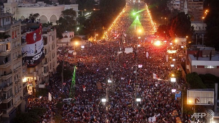 Hundreds of thousands of Egyptian demonstrators gather outside the presidential palace in Cairo  during a protest calling for the ouster of President Mohamed Morsi. (AFP/Mahmud Khaled)