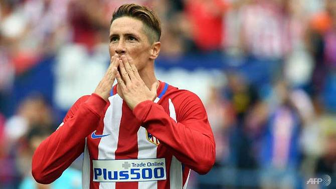 torres extends atletico deal for an extra year
