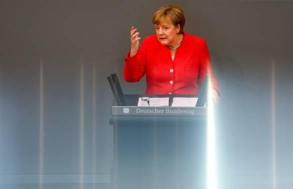 merkel warns trump against trade war